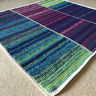 Image shows the Tunisian Temperature Blanket from Nona Davenport from Ravelry.