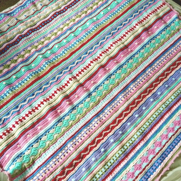 Image shows the As-We-Go Stripey Blanket from Not Your Average Crochet.