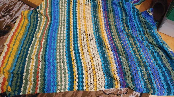 Image shows the Shell Stitch Temperature Blanket.