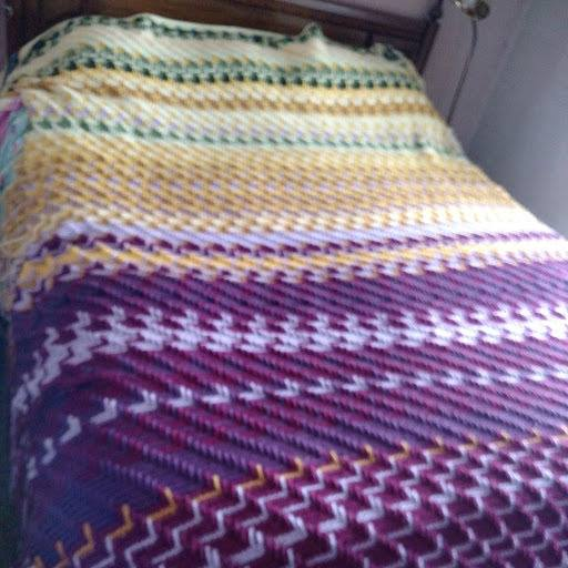 Image shows the Apache Tears Crochet Temperature Blanket.