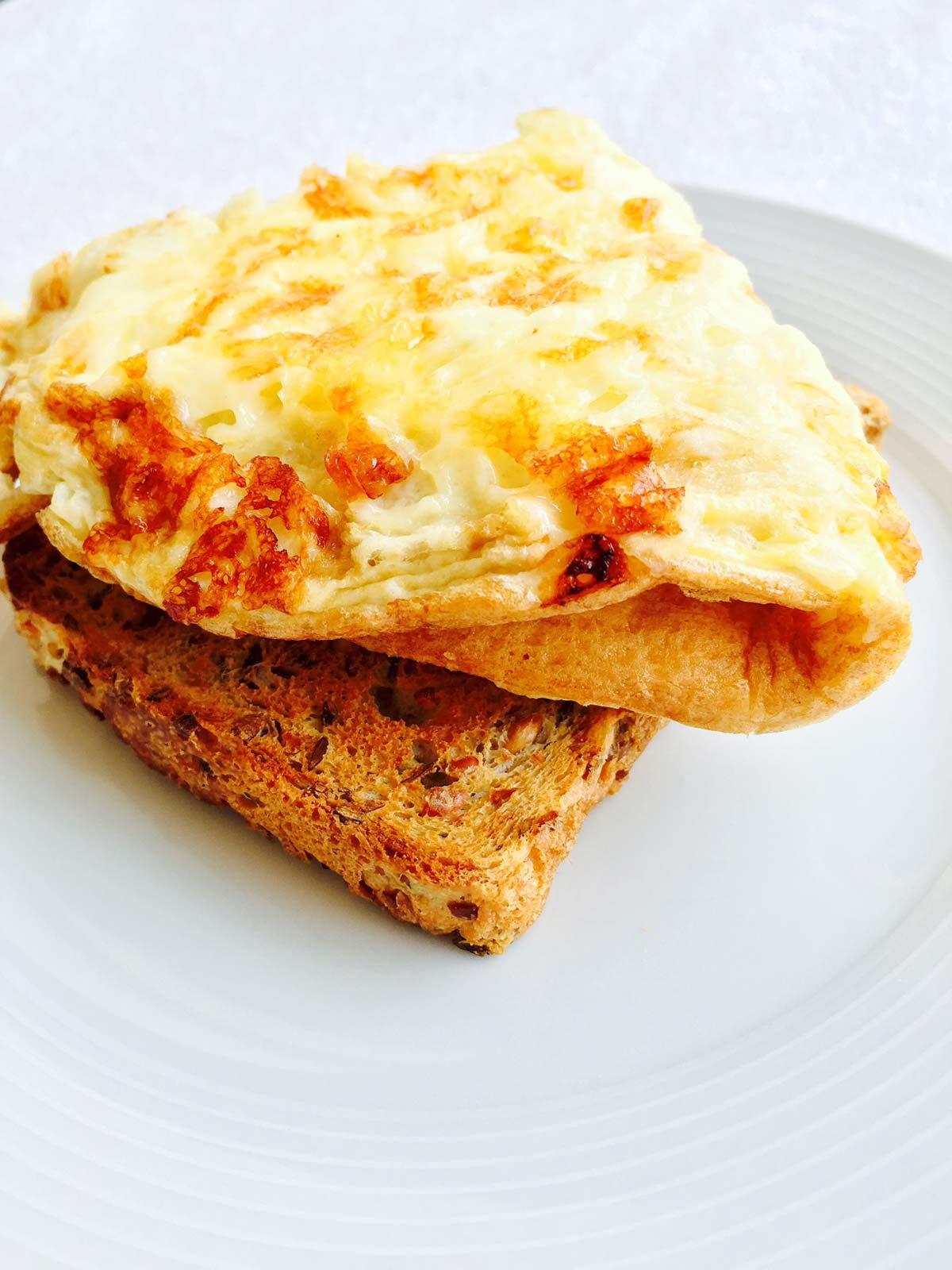 Breakfast Cheese Omelette on Toast   AllFreeCopycatRecipes.com