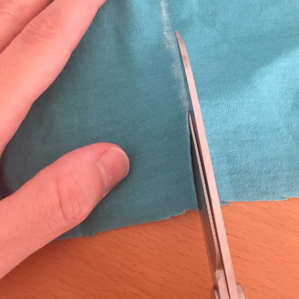 Example showing correct way of cutting fabric.
