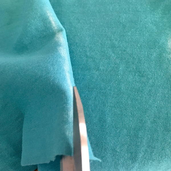 Example showing incorrect way of cutting fabric.