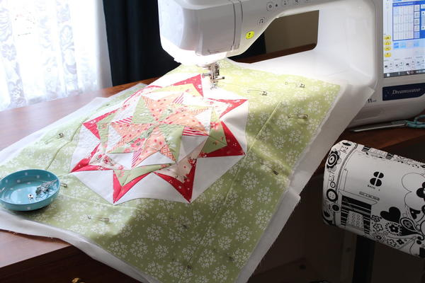 Reignite Your Creative Spark - image shows a sewing machine and quilted fabric square.