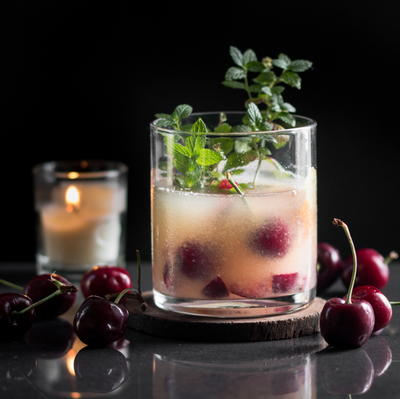 Orange Whisky Sour Cocktail with Cherries