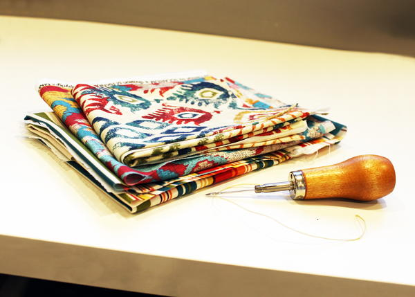 Example of canvas and sewing awl.
