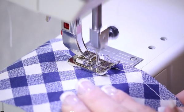 Image shows the basting stitch being sewn on a sewing machine.