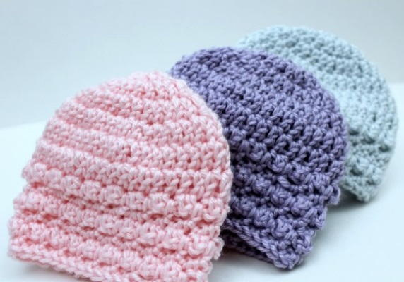 Images shows Little Textures Newborn Beanies.
