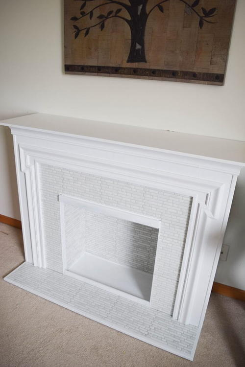 Fireplace surround makeover with peel and stick tile!