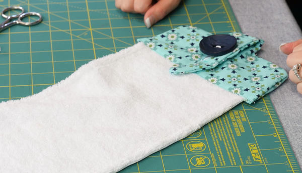 Image shows the finished towel with loop buttoned.