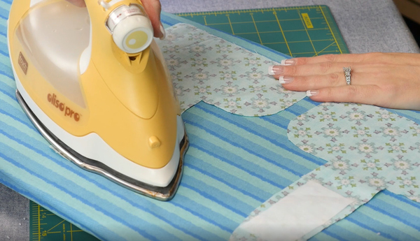 Image shows interface being ironed onto the two fabric top towel pieces.