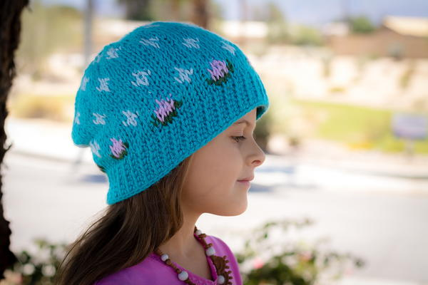 Image shows a child wearing the Rainy Spring Beanie outside.