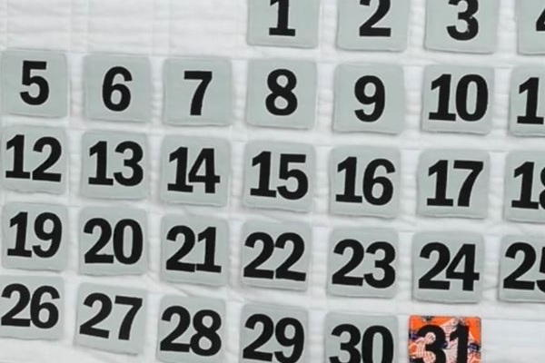 Image shows a close up of the finished quilted wall calendar.