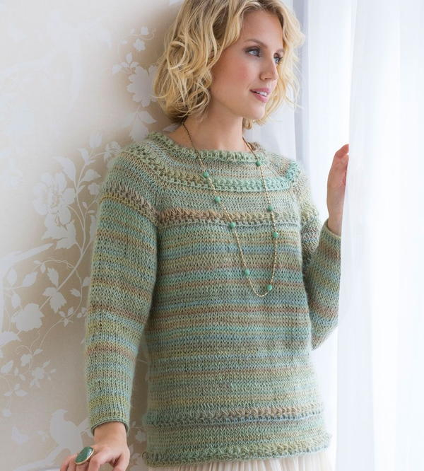 image shows the Tunisian Stitch Crochet Sweater on a model.