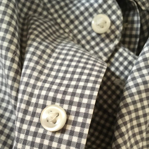 Shirt with buttons.