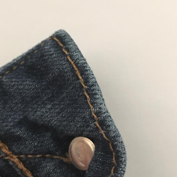 Jeans with a button.