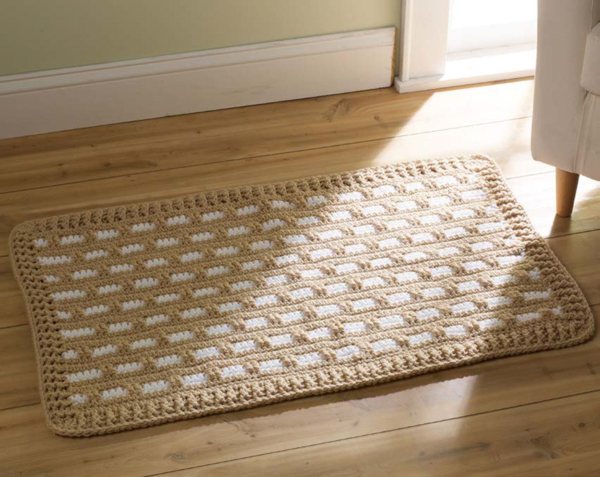 Image shows the Contemporary Classic Crochet Rug on a wood floor.