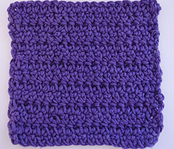 Image shows a purple extended single crochet stitch swatch on a light gray background.