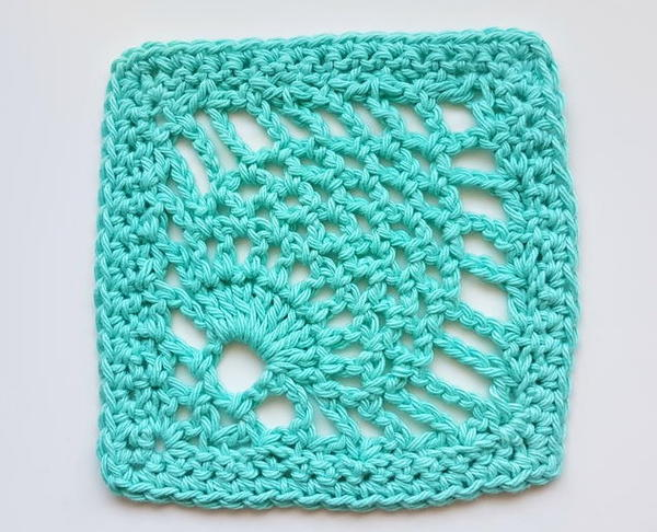 Image shows a teal pineapple stitch crochet swatch on a light gray background.