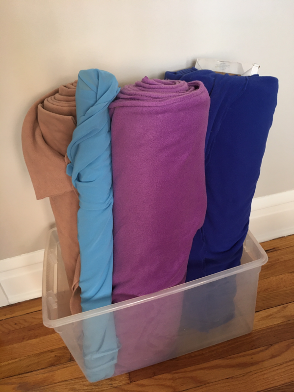 Image shows a clear tub full of fabric.