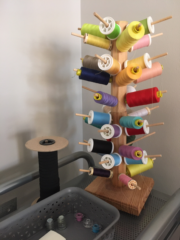Image shows a thread tree and box of bobbins.