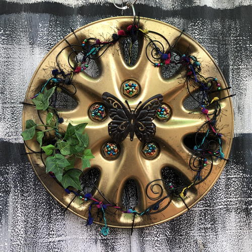 Radiant Black Butterfly Hubcap Art
