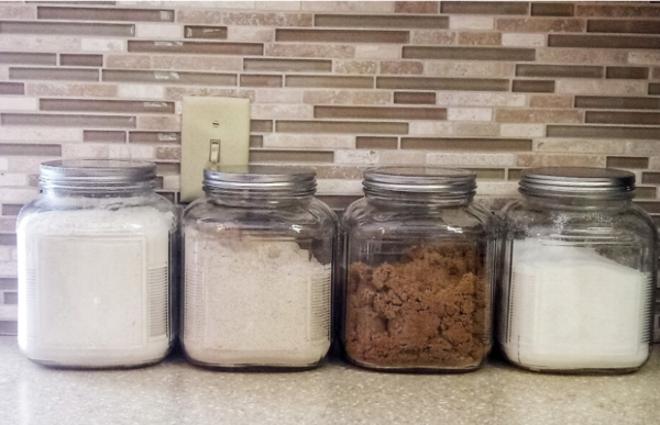 Canisters containing flour and sugar