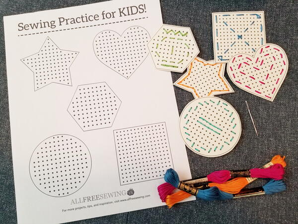 Image shows the printed sewing card sheet and cut out shapes that were sewn using different-colored embroidery floss. Three embroidery floss packages are below.