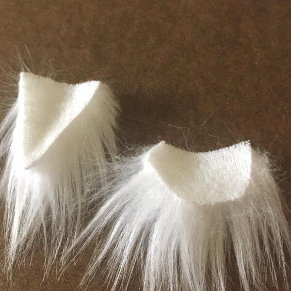 Image shows the cut white faux fur fabric beard pieces for the DIY Gnome Ornament.
