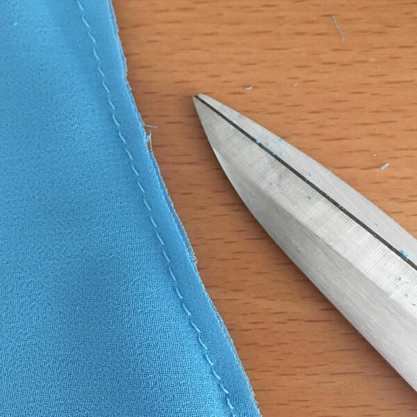 Image shows Step 3 (after) for how to sew French seams.