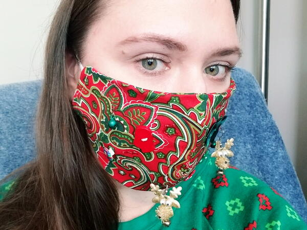 Image shows a woman wearing a DIY Ugly Face Mask for Christmas.