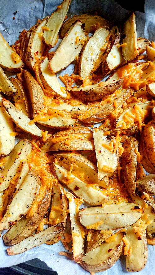 Spicy Cheesy Dairy Free Potato Wedges