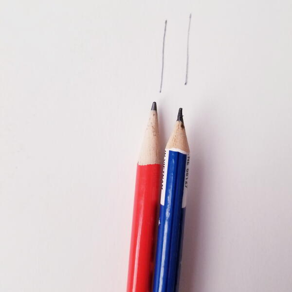 Two pencils marked seam allowance