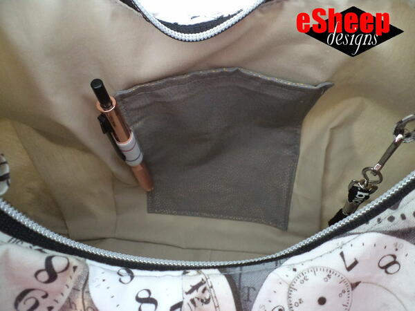 Image shows a handmade purse that has a patch pocket with a little extra.