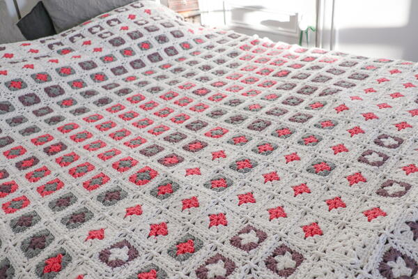 Image shows the Adding Up Memories Temperature Blanket from Rachel Hill from Ravin Sekai Designs.