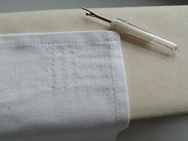 Image shows fabric with the stitches removed (via seam ripper).
